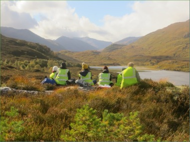 Not a bad place to end a day's work! A pause after having assessed the spontaneous regrowth of an area of the glen in which deer numbers had been decreased and tree succession was taking place again. Photo courtesy of Trees for Life, 2018.